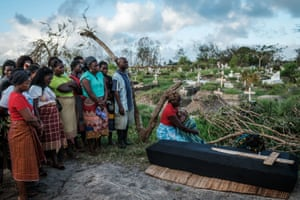 Beira, MozambiqueRebecca Albino (R) mourns her husband, Tomas Joaquim Chimukme during his funeral following cyclone Idai which cut a swathe through Mozambique, Zimbabwe and Malawi. The confirmed death toll stood at more than 300.