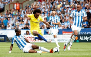 Chelsea's Willian skips over the challenge from Huddersfield's Terence Kongolo as Chelsea win 3-0 at the John Smith's Stadium.