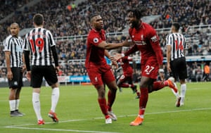 Divock Origi celebrates scoring a late winner for Liverpool in their 3-2 victory at Newcastle. His header could be a decisive strike in the title race, akin to his last-ditch goal against Everton earlier in the season.