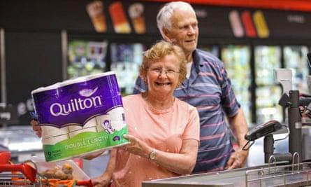Customers shop for essentials at a Coles supermarket