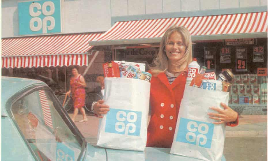 A woman with her groceries outside a Co-op in the 1960s