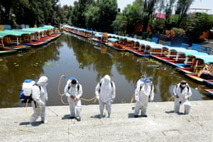 Workers disinfect the Trajineras Xochimilco, a tourist attraction where visitors can ride a gondola through the canals in Mexico City. Mexico is on stage three of health emergency, as deaths and positive cases grow.