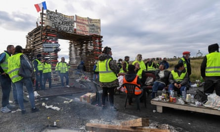 Gilets jaunes protesters block the road leading to the Frontignan oil depot in the south of France.