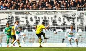 Borussia Dortmund's Jadon Sancho scores their first goal.