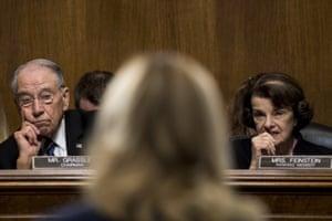 Senators Chuck Grassley and Dianne Feinstein listen as Ford testifies