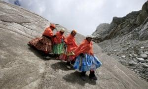 Aymara indigenous women practise descending on a glacier at Huayna Potosí mountain
