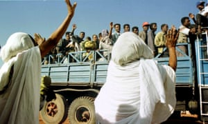 Ex-fighters of the Eritrean People's Liberation Front depart from Asmara to the Ethiopian border in 1998.