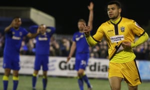 Maxime Biamou celebrates scoring Sutton's second goal against AFC Wimbledon as the non-league side secured a place in the fourth round.