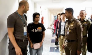 Saudi woman Rahaf Mohammed al-Qanun (second left) is escorted by a Thai immigration officer and UNHCR officials at the Suvarnabhumi international airport in Bangkok on Monday.