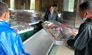 Undertakers prepare coffins in a funeral parlour in central China.