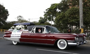 A hearse drives along a street as part of a campaign, carried out by the Colombian National Police and the San Vicente funeral home, calling for residents to stay home, in Medellin, Colombia, 29 March 2020.