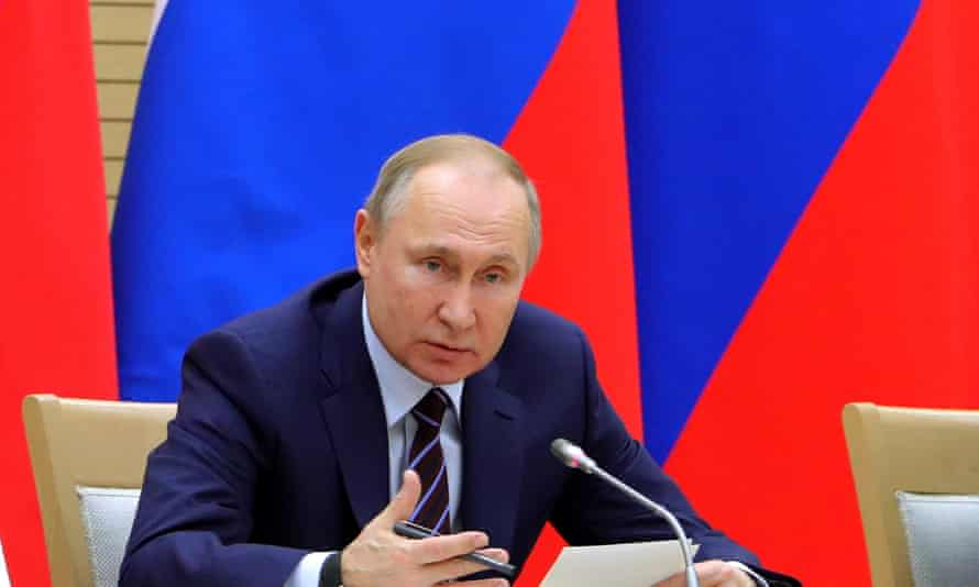 Vladimir Putin chairing a meeting on drafting constitutional changes at the Novo-Ogaryovo residence outside Moscow, Russia, on Thursday
