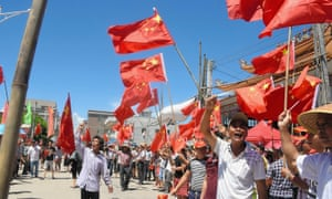 Villagers stage a protest in Wukan, Guangdong Province, China in June 2016. Police stormed homes in the village on Tuesday but were met with fierce resistance .