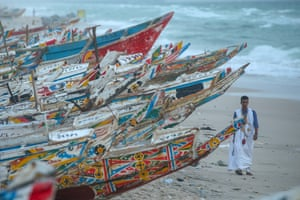 Nouakchott, Mauritania A fisherman walks past wooden fishing boats stacked on the shore in Nouakchott. Fishing is one of the most important sources of income in Mauritania, a West African country with 754 km of coastline along the Atlantic Ocean