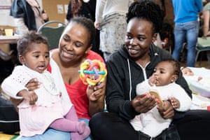 Rahma, left and baby Tiamadu, and Afia with five-month-old Camille at east London's Magpie project.