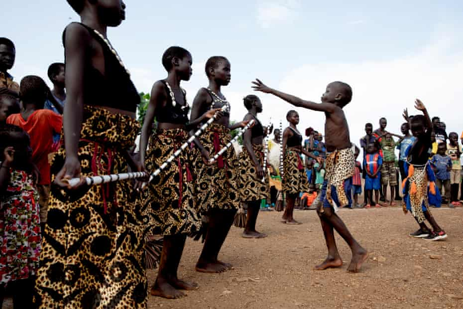 The Maale dance group perform at a camp for internally displaced people in the suburbs of Juba