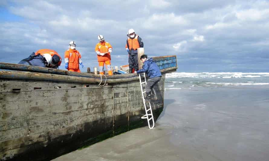 Japanese coastguard officials found eight bodies inside this battered wooden boat off northern Akita prefecture