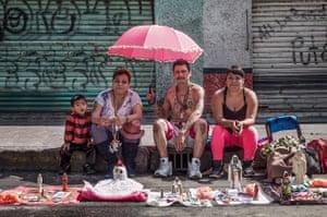 The Martinez Family wait at the roadside at a Santa Muerte parade, Tepito, Mexico City.