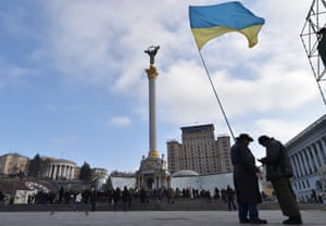 Activists wave a Ukrainian flag on Independence Square in Kiev in February.