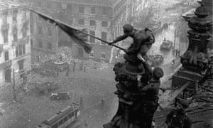 Soviet soldiers hoist the red flag over the Reichstag in May 1945