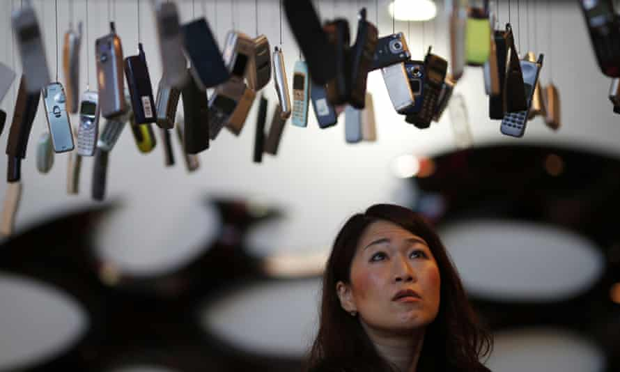 Upwardly mobile: a visitor looks at an art installation by collector Yuichi Kogure in Tokyo.