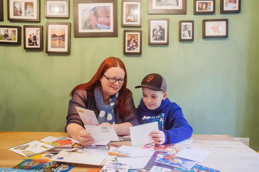 Molly Povey and son Roman with cards he was sent by strangers all over the world after she posted on Facebook about his loneliness
