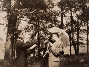 Postcard Undated, 85 × 110 mm Provenance: US  Circa 1900, of two well-dressed young men sharing an umbrella.