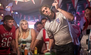 Sacha Baron Cohen; Rebel Wilson and Johnny Vegas in a scene from Grimsby