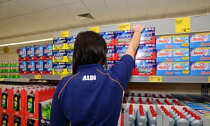 A store assistant stocking shelves in Aldi supermarket