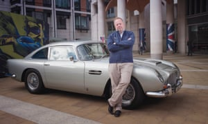 Andy Palmer, the CEO of Aston Martin, with a 1963 DB5 outside the London Stock Exchange.