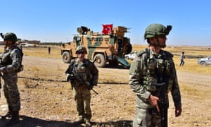 Turkish and US soldiers patrol together in Northern Syria, in Tal Abyad, near Turkey border in Syria.