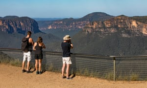 Tourists looking at the views across the Grose Valley at Govetts Leap Lookout, Blackheath