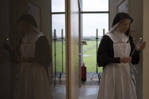 A Benedictine Nun lights candles