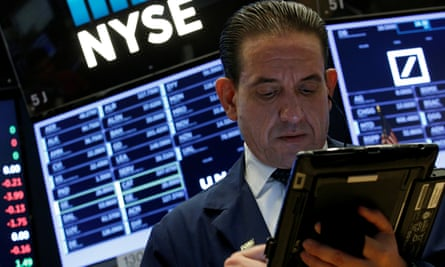 A trader works on the floor of the NYSE in New York