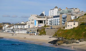 The Tate, St Ives seen across Porthmeor Beach, Cornwall, UK.