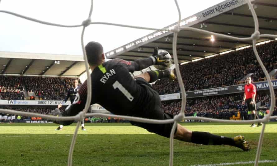 Brighton's Mathew Ryan makes a save during the penalty shootout against Millwall's Mahlon Romeo