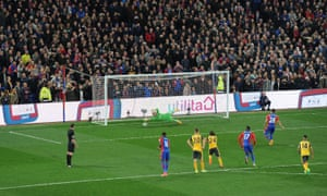 Milivojevic's penalty beats Emiliano Martinez for the third.