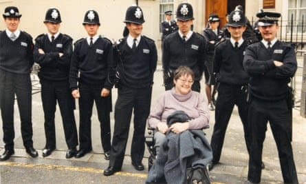 Lorraine Gradwell in a demonstration at Conservative Central Office in the 1990s, with a contingent of police officers.