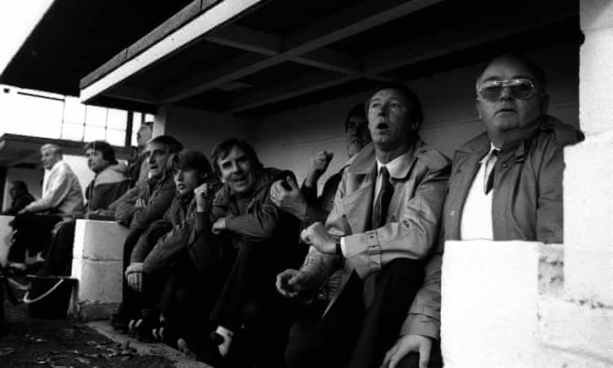 Sir Alex Ferguson, centre, at the Manor Ground for his first match as Manchester United manager in November 1986. Derek Sutton is sat to his left for the first and last time