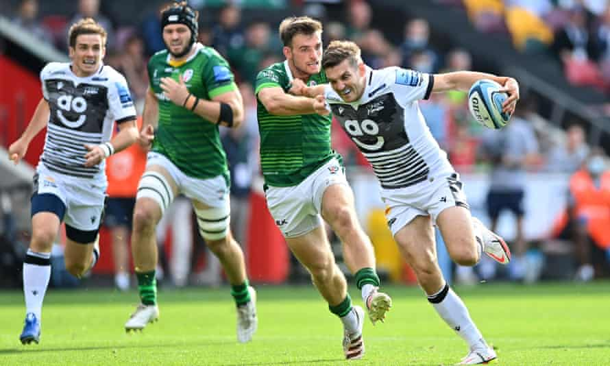AJ MacGinty of Sale takes on the London Irish defence.