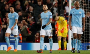 Manchester City's Nicolas Otamendi and Vincent Kompany look dejected after Liverpool's Sadio Mane scored their third goal.
