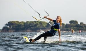 Woman kitesurfing in Sicily