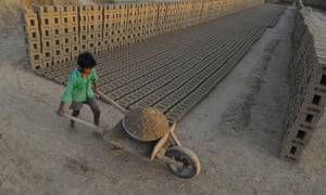 An Indian boy working at a brick kiln. Brick kiln workers in India are trapped in a cycle of bonded labour and regularly cheated out of promised wages, Anti-Slavery International said Wednesday, urging the government to safeguard their rights.