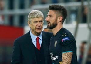 Olivier Giroud celebrates with manager Arsene Wenger.
