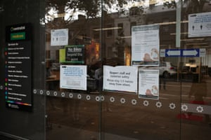 Signs are seen outside a Centrelink office in Sydney.