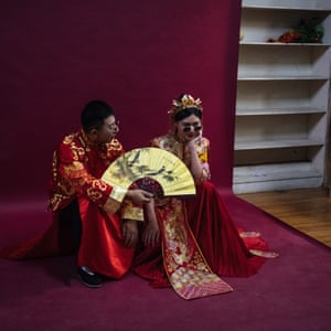 A couple pose at 27 Rome Brand photo studio