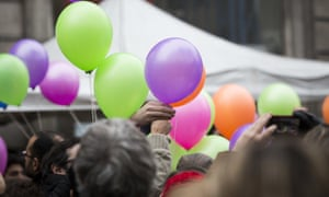 People prepare to release balloons at the Paris 11th district town hall