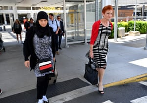 One Nation leader Pauline Hanson (right) crosses paths with Layla from Logan at Brisbane Airport on Tuesday morning