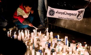 People attend a candlelight vigil for victims of the Colombia plane crash in Bogotá, Colombia