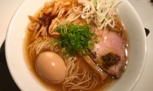 Ramen bowl with whole egg in still in shell.